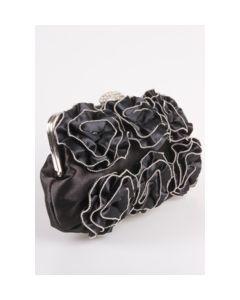 Zwart avondtasje met rozetten afgezet met zilverkleurige piping
