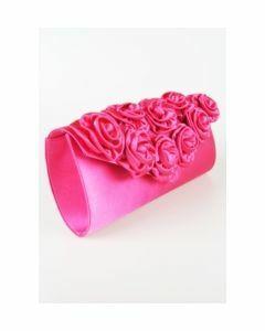 Hot pink satijnen avondtasje afgewerkt met satijnen rozetten